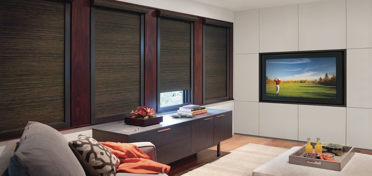 A media room with built-in TV and hidden cables.